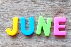 June in multicolor magnets with wood background